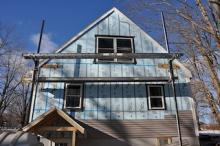 Home being insulated to increase performance and decrease heat loss